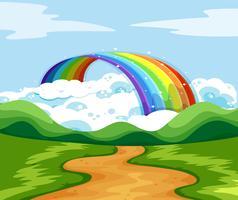 Scena della natura con arcobaleno alla fine della strada
