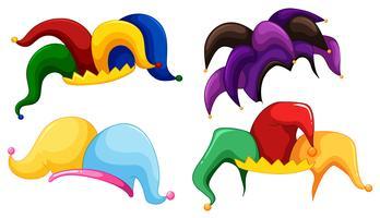 Cappelli da giullare in diversi colori vettore