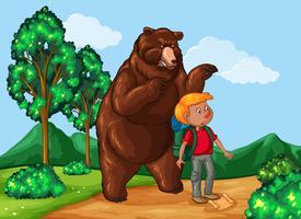Escursionista e orso grizzly nel parco