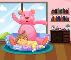 Bambina che dorme con teddybear rosa