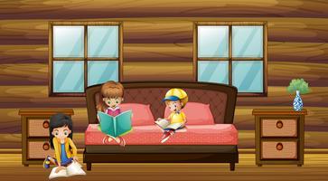 Tre bambini che leggono libri in camera da letto