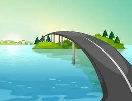 Una lunga strada sopra il fiume vettore