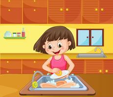 Un piatto di pulizia della ragazza in cucina vettore