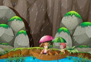Ragazzo e ragazza barca a remi in giornata di pioggia