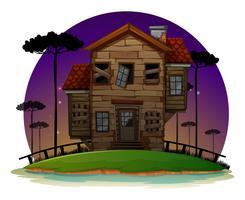 Vecchia casa di legno di notte vettore