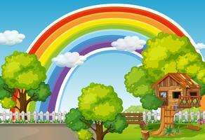 Scena di sfondo con arcobaleno e casa sull'albero