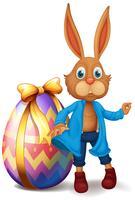 Coniglietto marrone e uovo di Pasqua vettore