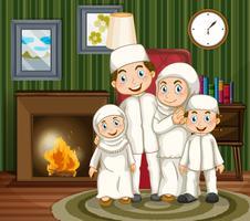 Famiglia musulmana accanto al caminetto nel soggiorno