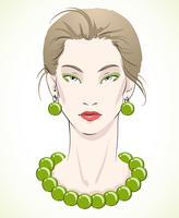 Elegante giovane modella con perle verdi