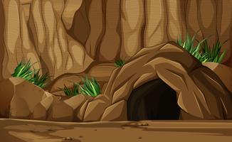 Scena di sfondo con grotta in montagna vettore