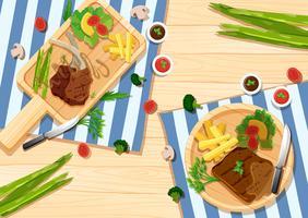 Modello di sfondo con bistecche e verdure