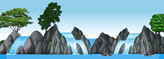 Tre piccole cascate e un grande lago vettore