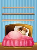 Bambina che dorme nel letto