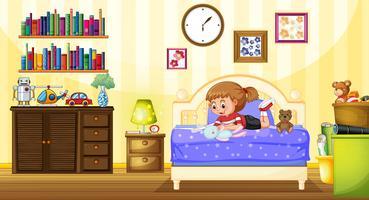 Bambina che gioca con la bambola in camera da letto