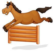 Un cavallo salta sul recinto di legno vettore