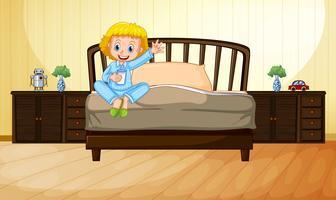 Bambina che beve latte in camera da letto