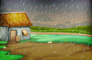 Scena di campagna con poca capanna sotto la pioggia