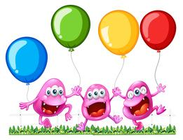 Tre mostri che giocano con i palloncini