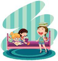 Tre bambini che leggono libri in camera da letto vettore