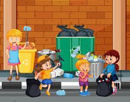 I bambini si offrono volontari per ripulire la città vettore