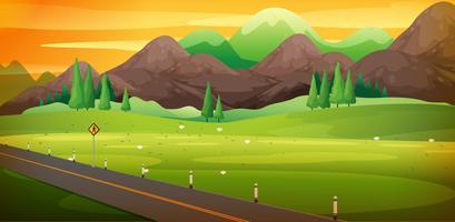Strada di campagna con bella scena di montagna vettore