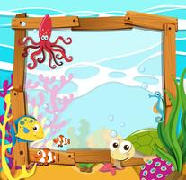 Progettazione del confine con animali marini vettore