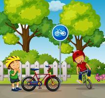 Due ragazzi in sella alla bici nel parco vettore