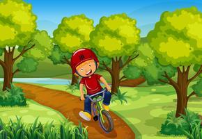 Bici di guida del ragazzino nel parco vettore