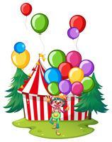 Clown del circo con palloncini colorati