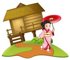 Una ragazza giapponese sulla capanna di legno