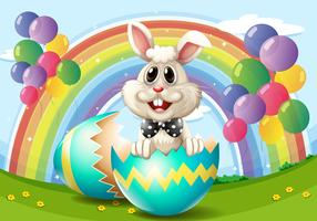 Coniglio di Pasqua con uova e palloncini
