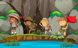Gruppo di boy scout in natura vettore