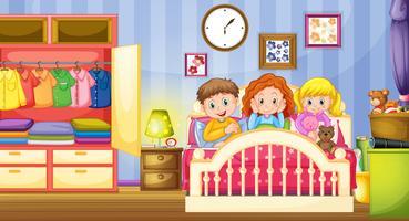 Tre bambini che dormono nella camera da letto