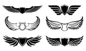 Set di pittogrammi di ali di piuma astratta vettore