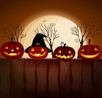 Zucca di Halloween alla notte della luna piena vettore
