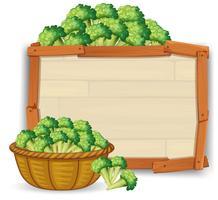 Broccoli sul bordo di legno vettore