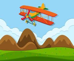 Un aereo che vola sopra il terreno vettore