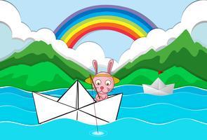 Barca di origami con la pesca del coniglio vettore