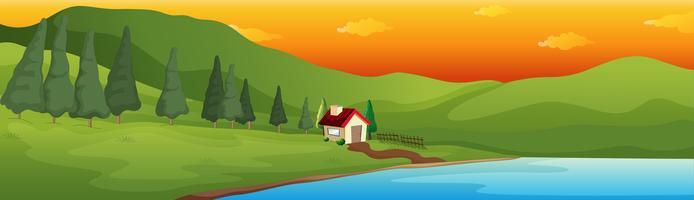 Una casa sul lago nella grande valle vettore