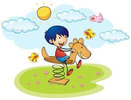Ragazzo che gioca sul cavallo a dondolo vettore