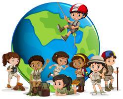 Scout multiculturale con globo vettore