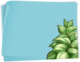 Modello di carta con foglie verdi su carta blu vettore