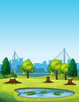 Scena del parco con stagno e alberi tagliati vettore