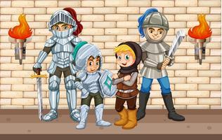 Quattro cavalieri in piedi vicino al muro
