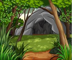 Scena di sfondo con grotta nella foresta vettore
