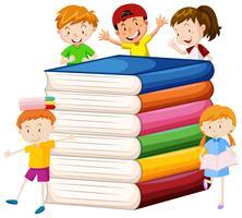 Grandi libri e bambini felici vettore