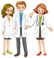 Tre medici in piedi insieme vettore