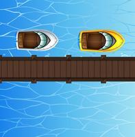Due motoscafi che galleggiano sul ponte vettore
