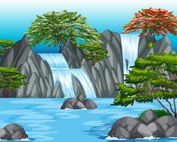 Scena di sfondo con cascata e alberi vettore