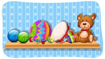 Palle e altri giocattoli sullo scaffale vettore